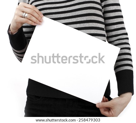 Human hand holding a piece of paper. - stock photo