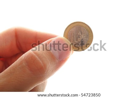 human hand holding an euro coin, isolated on white background - stock photo