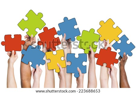 Human Hand Holding Colorful Jigsaw Puzzle Pieces - stock photo