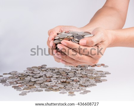 human hand holding currency metal coins on white background - stock photo