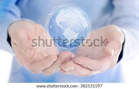 Human hand holding digital icon of planet earth - stock photo
