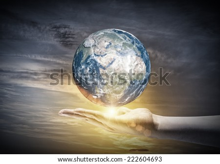 Human hand holding Earth planet. Elements of this image are furnished by NASA - stock photo