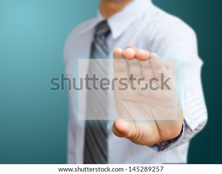 Human hand holding futuristic business card - stock photo