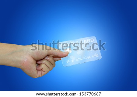 Human hand holding futuristic, transparent credit card - stock photo