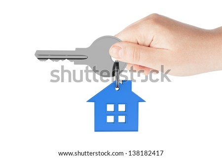 Human hand holding house key on a white background - stock photo