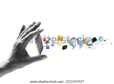 Human hand holding mobile phone and icons flying out - stock photo