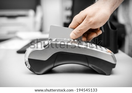 Human hand holding plastic card in payme - stock photo