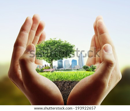 human hand holding the city  - stock photo