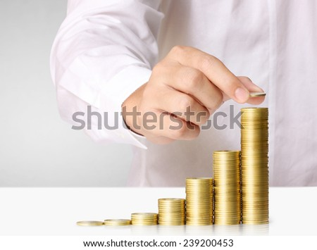 Human Hand human hand putting coin to money, business ideas - stock photo