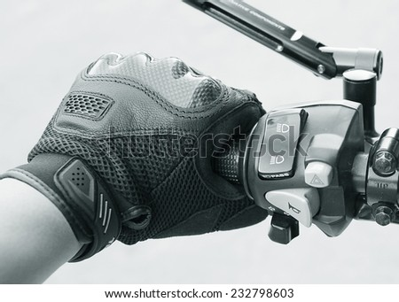 Human hand in a Motorcycle Racing Gloves Ready to ride ( black white ) - stock photo