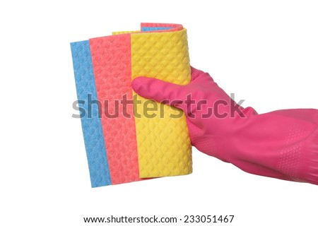 Human hand in glove holding asortment of sponge rags, dishrag isolated on white - stock photo