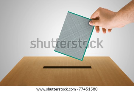 Human hand insert the electoral document on urn for voting - stock photo