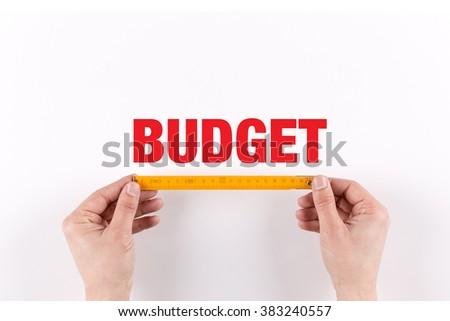 HUMAN HAND MEASURING BUDGET - stock photo