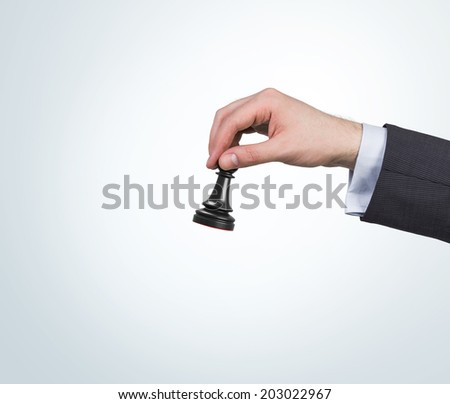 Human hand moves a chess pawn to win. - stock photo