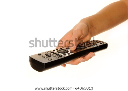 Human hand on remote - stock photo