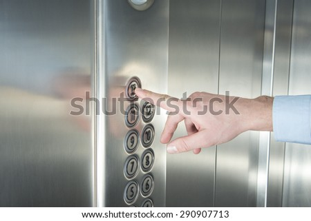 Human hand pressing the last floor button in the elevator - stock photo