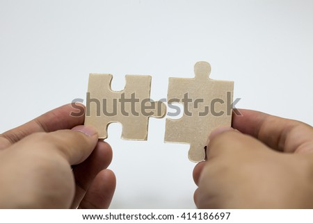 Human hands connecting pieces of jigsaw - Business team, solving problem together concept - stock photo