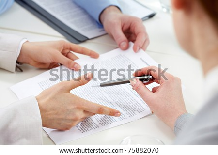 Human hands during discussion of business papers - stock photo