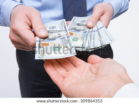 Human hands exchanging money - closeup shot - stock photo