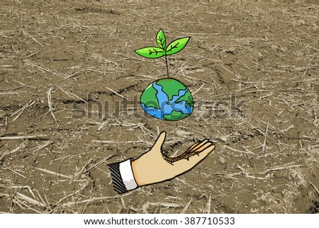 Human hands hold the green tree grow on earth over dry nature background. Ecology concept. Save the planet. - stock photo