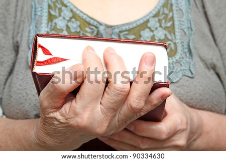 Human hands holding a book. - stock photo