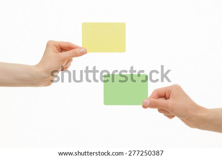Human hands holding colorful paper cards on white background - stock photo