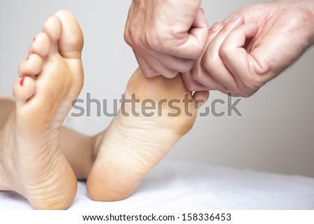 Human hands massaging a woman�s toe - stock photo