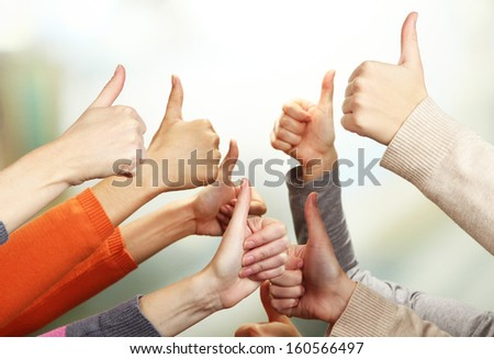 Human hands on bright background - stock photo