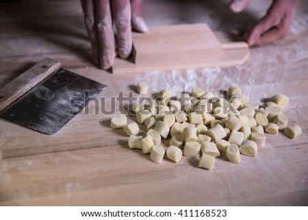 Human hands preparing homemade pasta - stock photo