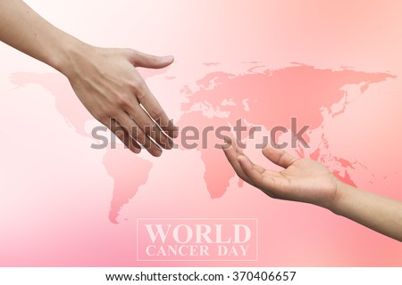 human hands reaching together for healing on world cancer day concept:man and woman hand touch for cheerful/hope/love idea:helping and prevent cancer awareness conceptual:medical treatment conception. - stock photo