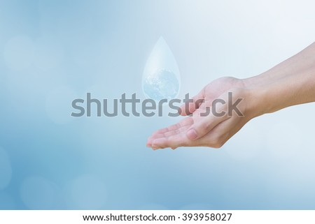human hands showing water drop with global inside for world water day concept:man gesture palm up to preserve energy of the planet:safe life ideal conceptual:Elements of this image furnished by NASA. - stock photo