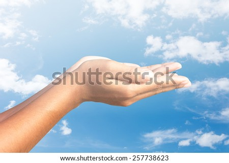 human hands  sky  background - stock photo