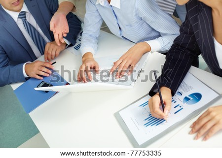 Human hands touching keyboard buttons in working environment - stock photo
