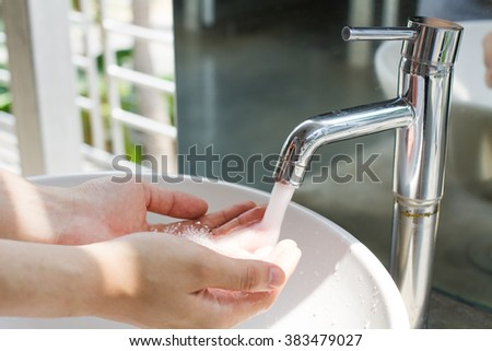 human hands with water splashing from tap, fresh water, save water save life, Environmental protection concept, World water day - stock photo