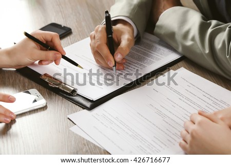 Human hands working with documents at the desk closeup - stock photo