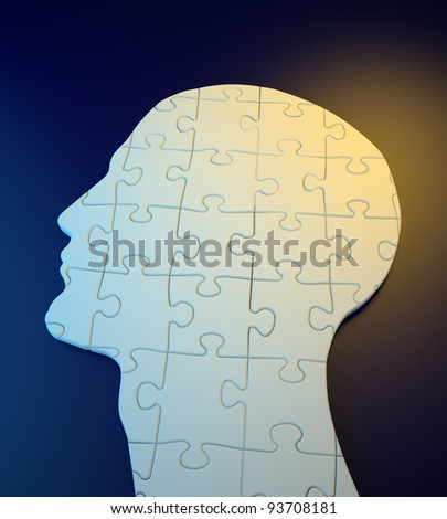 Human head build out of puzzle pieces - stock photo