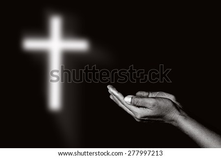 Human open empty hands and the light of God black background.abstract - stock photo