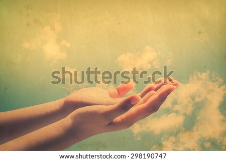Human open empty hands with palms up, over blurred nature background. - stock photo
