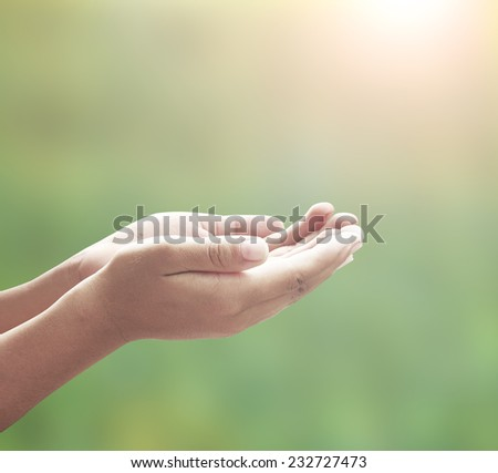 Human open empty hands with palms up, over blurred nature background. Thanksgiving Forgiveness Mercy Humble Repentance Reconcile Glorify Worship Redeemer Muslim Islam Love Trust Inspiration concept. - stock photo