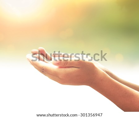 Human open two empty hand with palms up. Ask Seek Beg Help Race God Soul Pray Dua Hajj Give Bless Quran Aura Heal Life Gift Eid Islam Thanks Glow Prayer Macca Soul Creation Dream Source Nature concept - stock photo