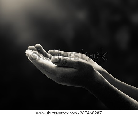 Human open two empty hands with palms up. Ask Pose Seek Beg Help Race God Soul Pray Dua Hajj Give Bless Quran Aura Heal Life Gift Eid Poor Idea Islam Thank Room World Candle Glow Prayer Macca concept - stock photo
