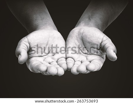 Human open two empty hands with palms up. Ask Pose Seek Beg Help Race God Well Relax Soul Pray Dua Hajj Give Child Girl Bless Quran Aura Heal Life Gift Eid Poor Idea Islam Thank Room World Candle Glow - stock photo