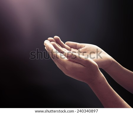Human open two empty hands with palms up. Ask Pose Seek Beg Help Race God Well Soul Praying Dua Hajj Give Bless Quran Aura Heal Life Gift Eid Poor Idea Islam Thank Room Candle Glow National Grace Day - stock photo