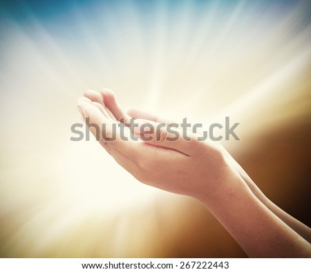 Human open two empty hands with palms up. Ask Pose Seek Help Race God Soul Pray Dua Hajj Give Bless Quran Aura Heal Life Gift Eid Poor Idea Islam Shaman Thank Room World Glow Prayer Macca Soul concept - stock photo