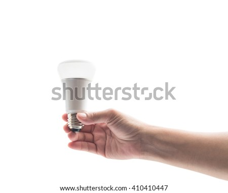 Human person's hand holding LED light emitting diode lightbulb energy saving bulb with tree on top on white background: Saving energy by eco friendly creative innovative technology design concept idea - stock photo