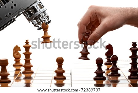 human playing chess with a machine - stock photo