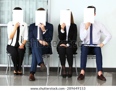 Human resource concept, Young businessman holding white billboard - stock photo