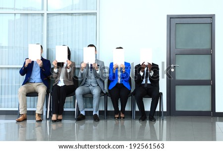 Human resource concept, Young businessman holding white billboard and waiting for job interview - stock photo