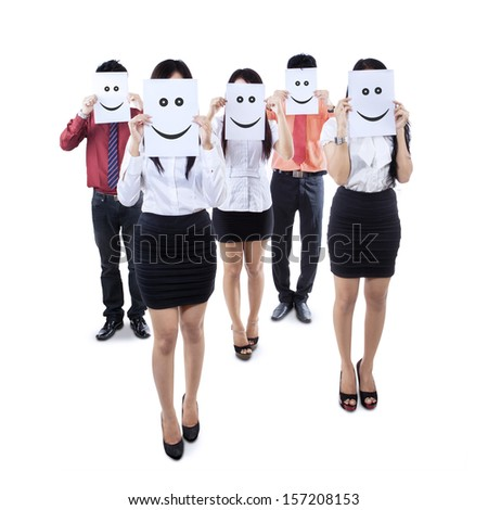 Human resource concept, Young businessman holding white billboard with a smile happy face on it - stock photo