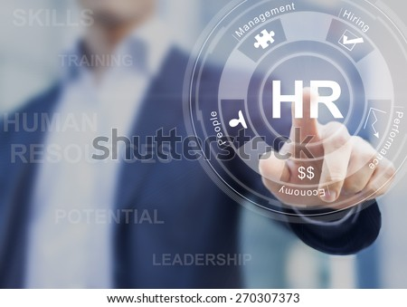 Human resources concept with manager in office touching white board computer interface about skills, training and performance - stock photo